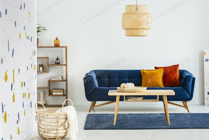 Lamp Above Wooden Table In Front Of Blue Sofa With Pillows In Mo Photo By Bialasiewicz On Envato Elements