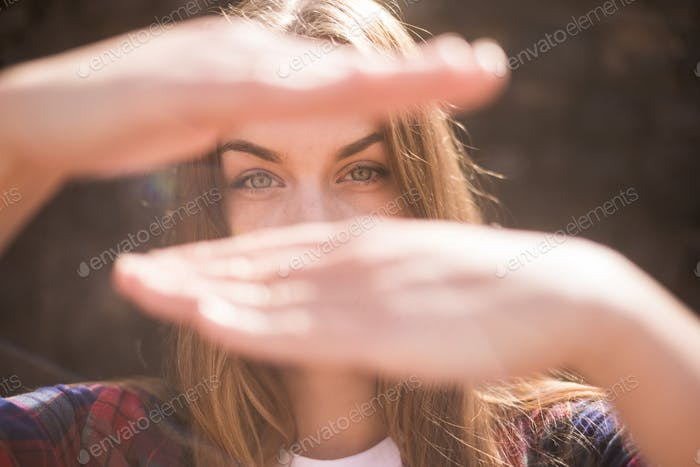 sunny portrait of beautiful model caucasian with blue eyes