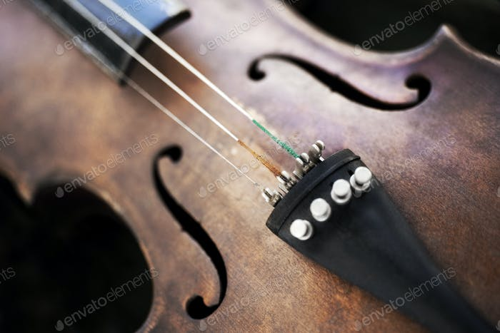 Close up of a violin with a broken string