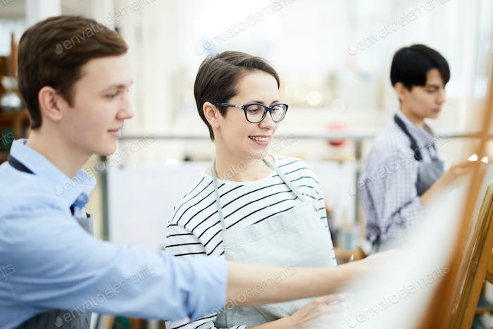 Smiling Woman Painting in Class