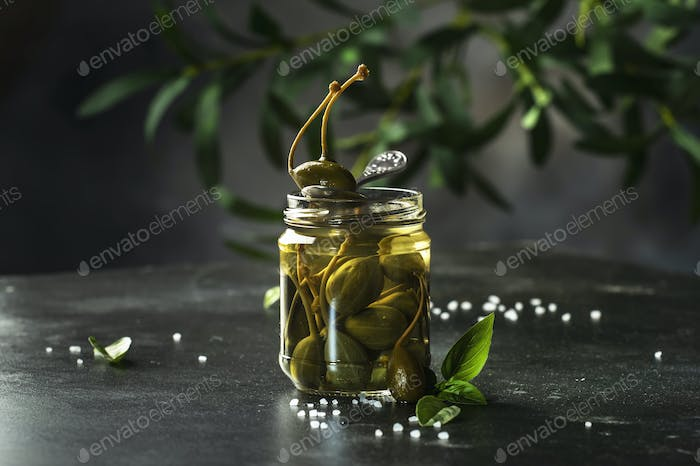 Capers. Marinated or pickled canned capers fruit close up