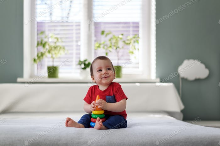 Smiling boy with toy