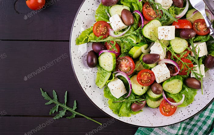 Greek salad with fresh vegetables, feta cheese and kalamata olives. Healthy food. Top view