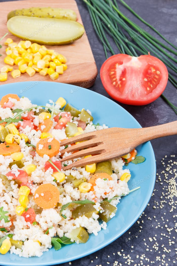 Fresh salad with couscous and vegetables