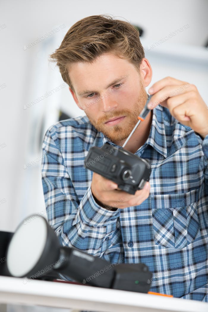 Man working on camera