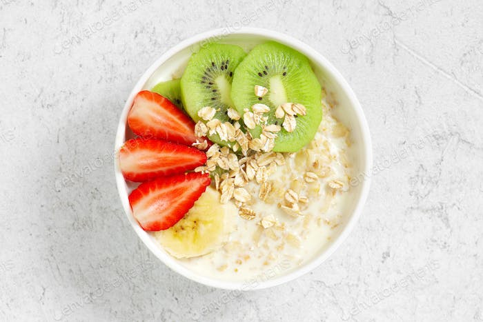 Bowl of Healthy Oatmeal and Fruits