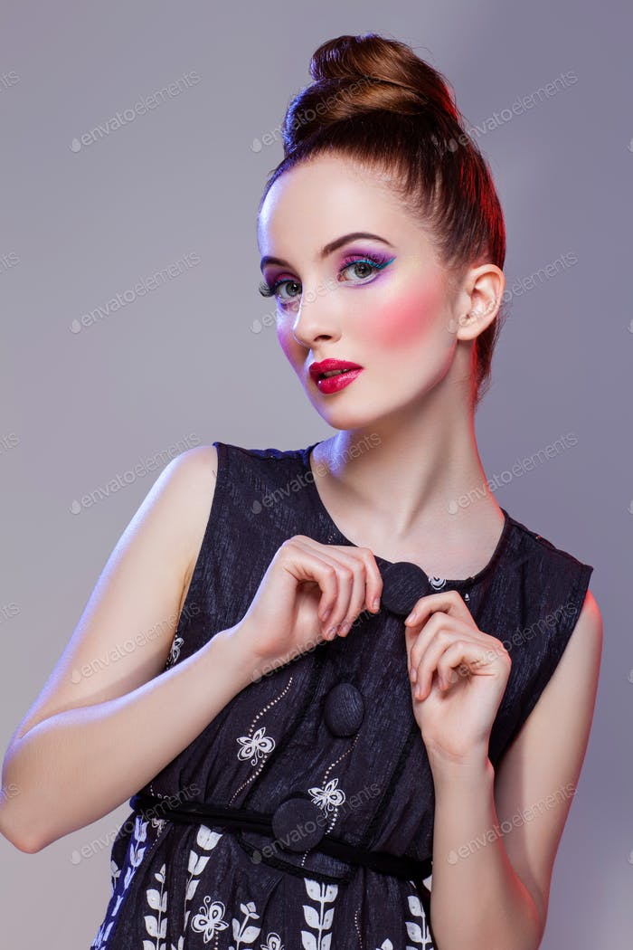 Beautiful girl with hairdo and bright make-up