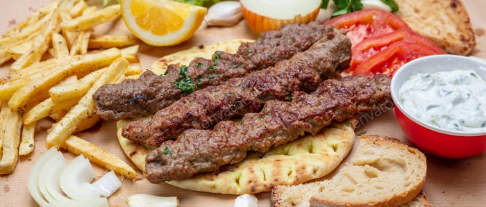 Kebab, traditional turkish, greek meat food on pita bread, top view