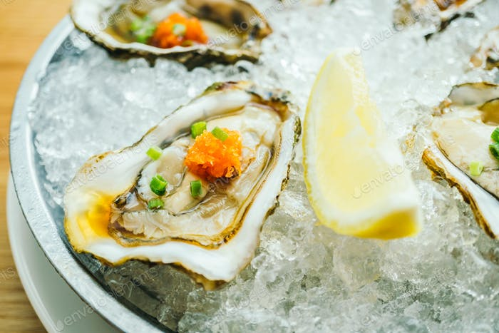 Raw and fresh oyster shell with lemon