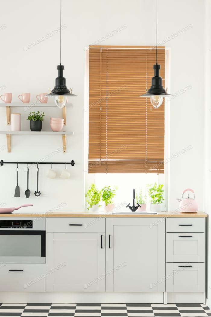 Real photo of a modern kitchen interior with wooden window blind