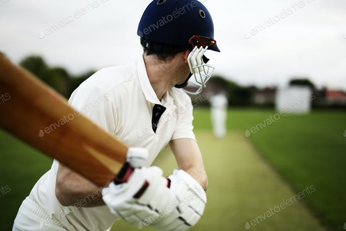 Cricketer on the field in action