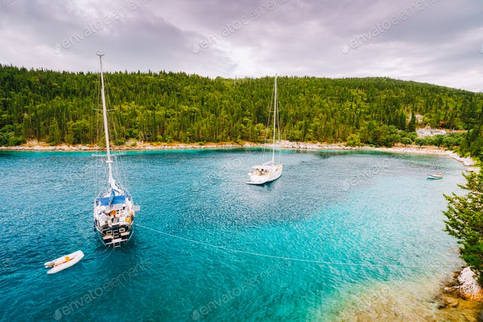 Foki beach near small town Fiskardo at Kefalonia, Ionian islands, Greece. Private yacht boats in the