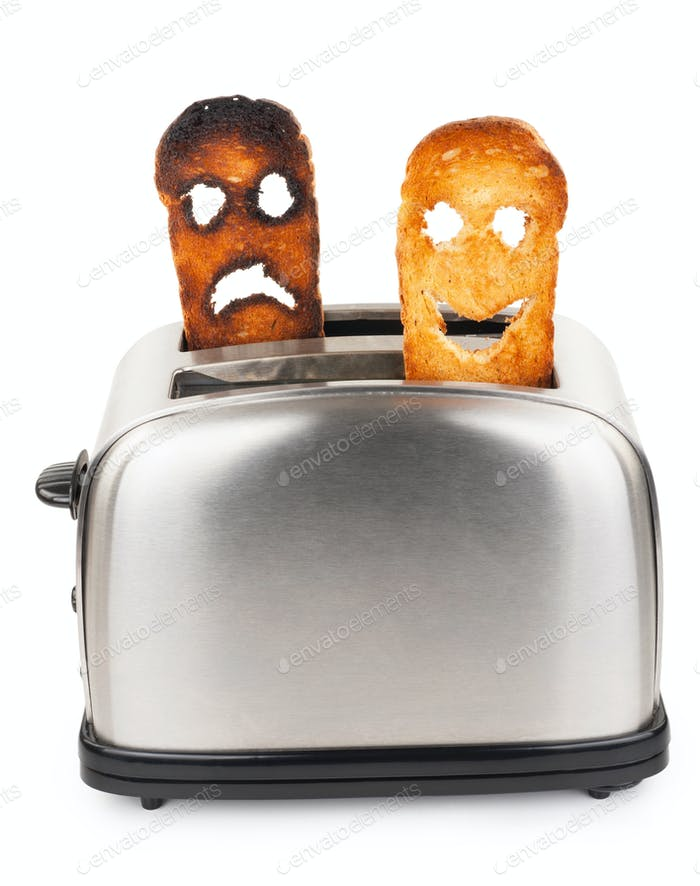 Toasts with smiley face in toaster