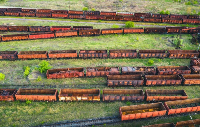 Aerial view of freight trains. Top view of old rusty wagons