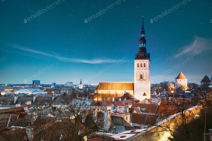 Tallinn, Estonia. Night Starry Sky Above Traditional Old Architecture Skyline In Old Town. St