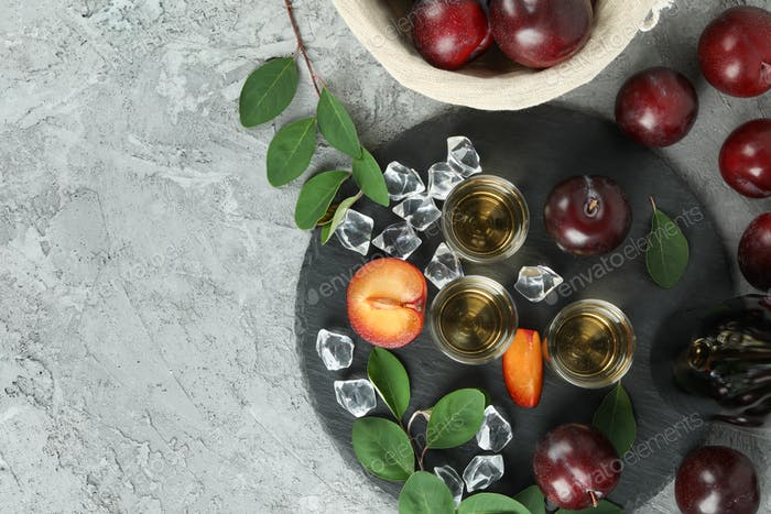 Concept of alcohol with plum vodka, top view