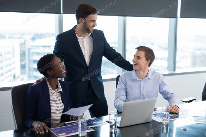 Executives interacting with each other