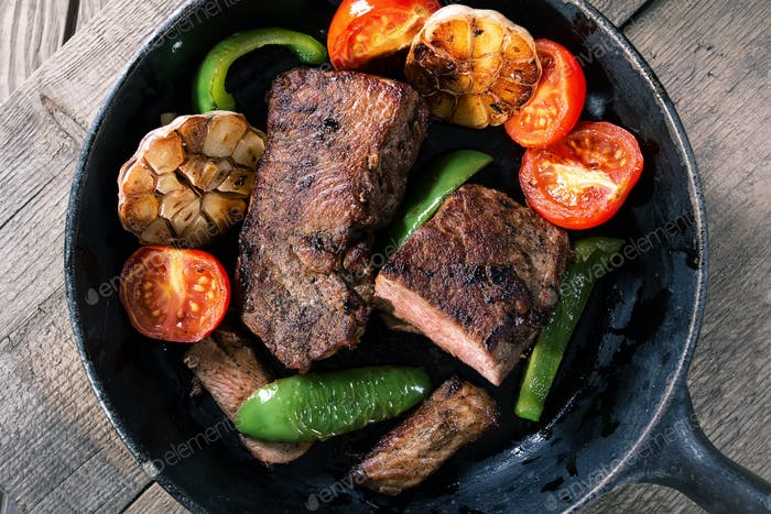 Appetizing beef steak with vegetables
