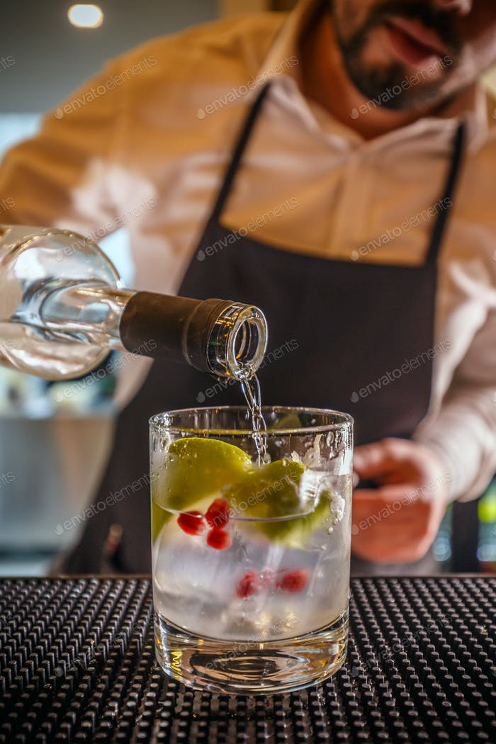 Bartender pouring vodka