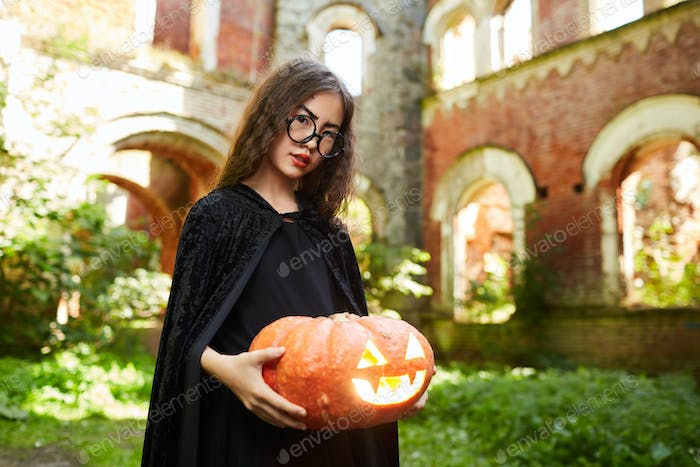 Asian Girl Dressed as Witch on Halloween