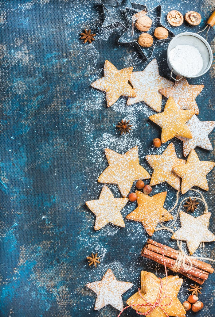 Christmas star shaped cookies with baking molds and spices