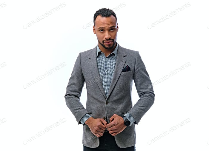 An elegant black male dressed in a suit isolated on white background.