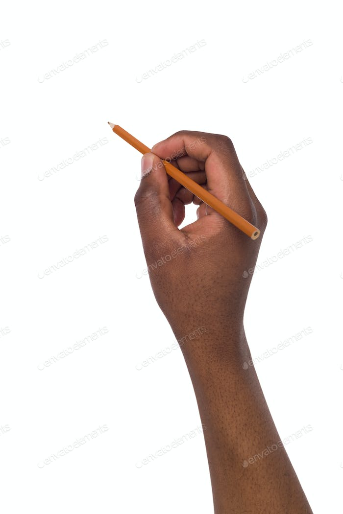 Black man hand holds a pencil. Copy space
