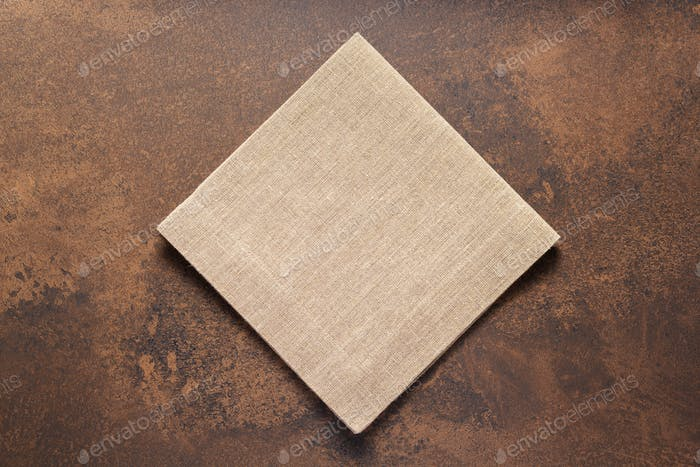 Folded burlap linen fabric  tablecloth at stone surface of table