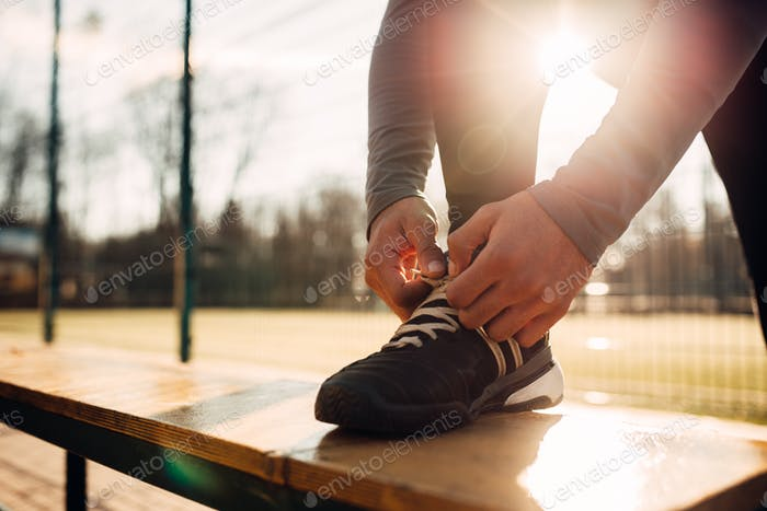 Male athlete doing stretching exercise before run
