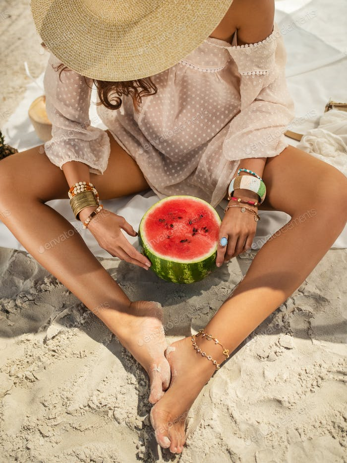 Woman on the Beach Eating Watermelon Outdoors