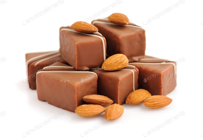 Chocolate praline with almonds on white background
