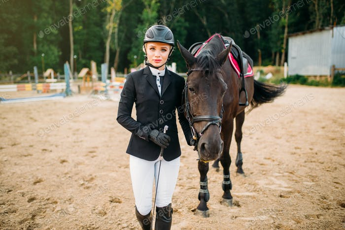 Equestrian sport, female jockey and horse