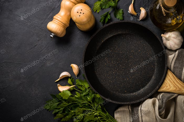 Frying pan or skillet on black table