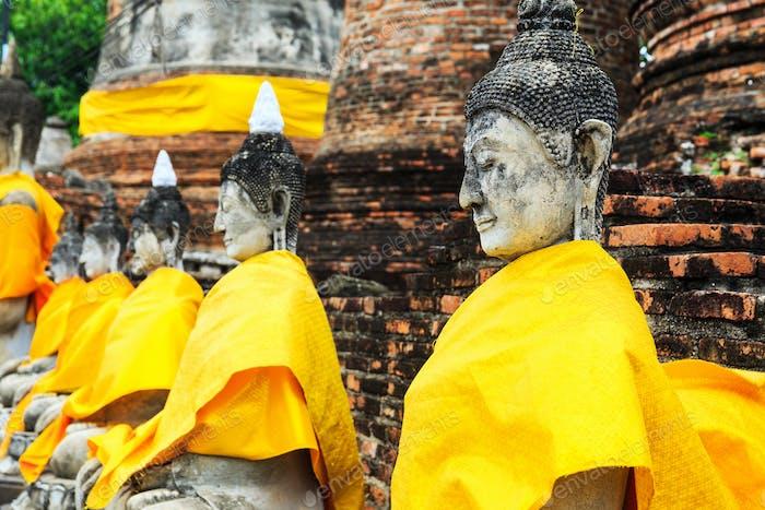 Ancient Buddha in a row