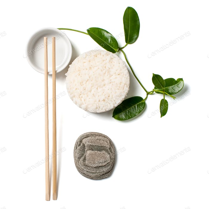Minimalistic composition with white rice and chopsticks on white