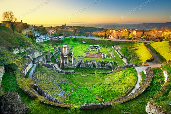 Volterra, roman theatre ruins at sunset. Tuscany, Italy.