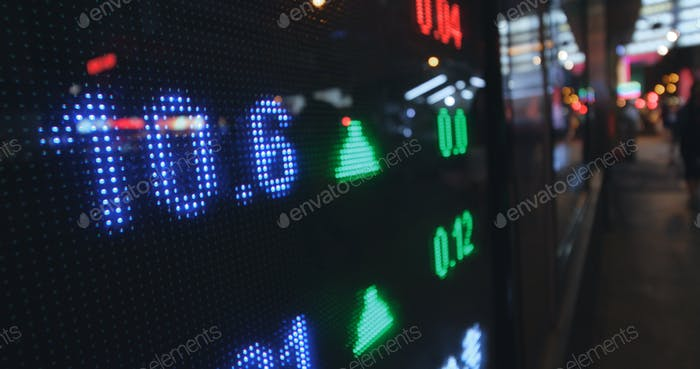 Stock market prices showing on the screen