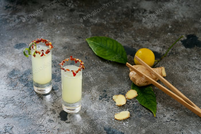 Ginger lemon shot. Immune boosting health defending drink.