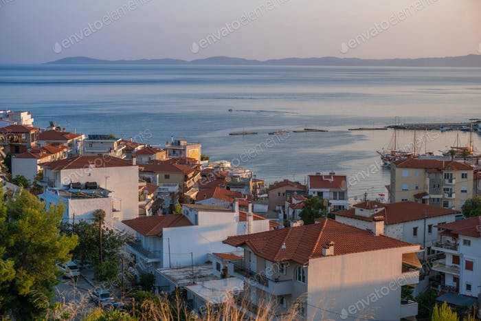 Sea and houses with red roofs in Greece aerial view