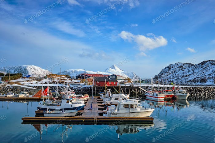 Fishing boats and yachts on pier in Norway