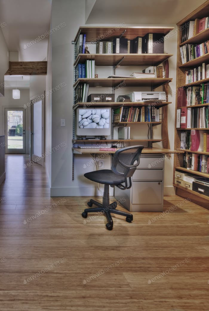 Empty desk and bookshelves in natural healing clinic office
