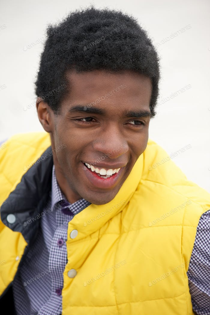 Portrait of a young black man with happy expression on face