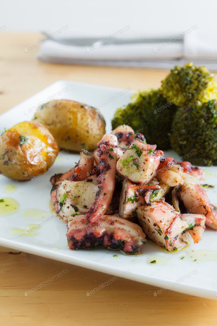 Octopus in Olive Oil with roasted potatoes and broccoli