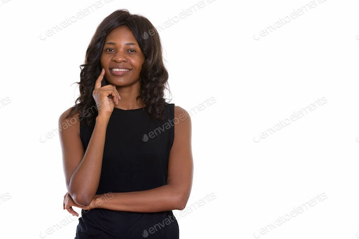 Studio shot of young beautiful African woman with wig