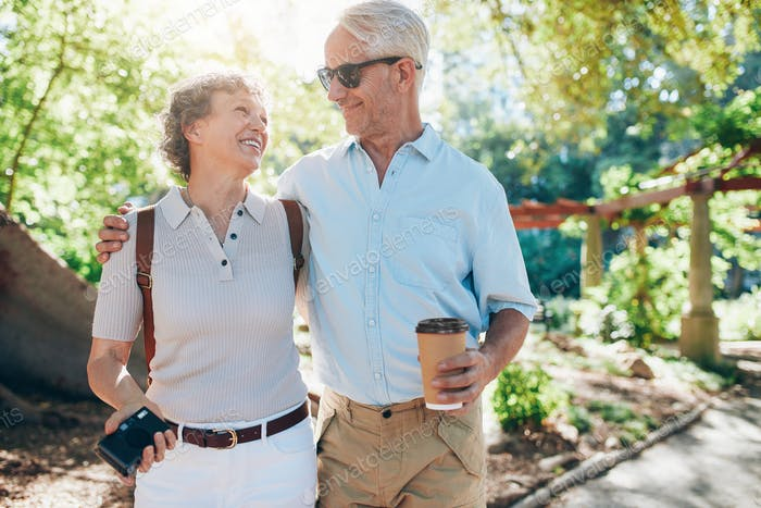 Loving mature couple walking together in a park