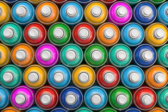 Top view of colorful graffity spray paint cans or bottles of aerosol.