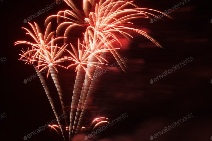 Volleys of fireworks in the night sky