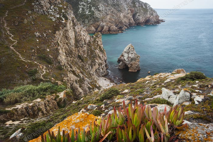 Rock cliffs by the sea at Beach Lourical on Cabo da Roca, Sintra, Portugal