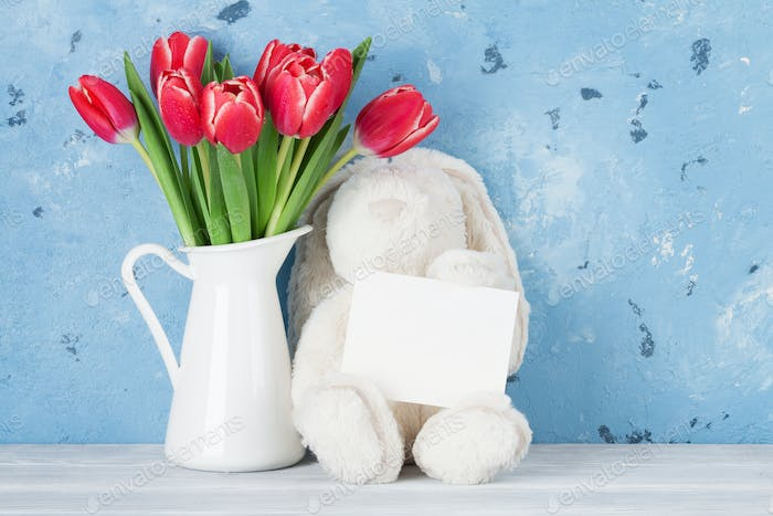 Red tulip flowers and easter rabbit toy