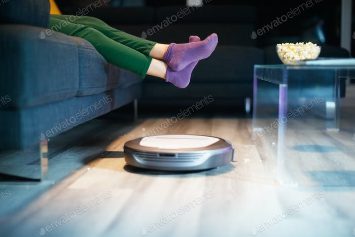 Robot Cleaning Floor While Child Watches TV Movie